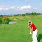 Blonde girl golf player — Stock Photo