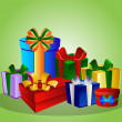Colorful gift boxes on green background — Stockfoto