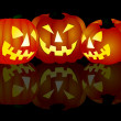 3 Halloween pumpkins on black background — Stock Photo