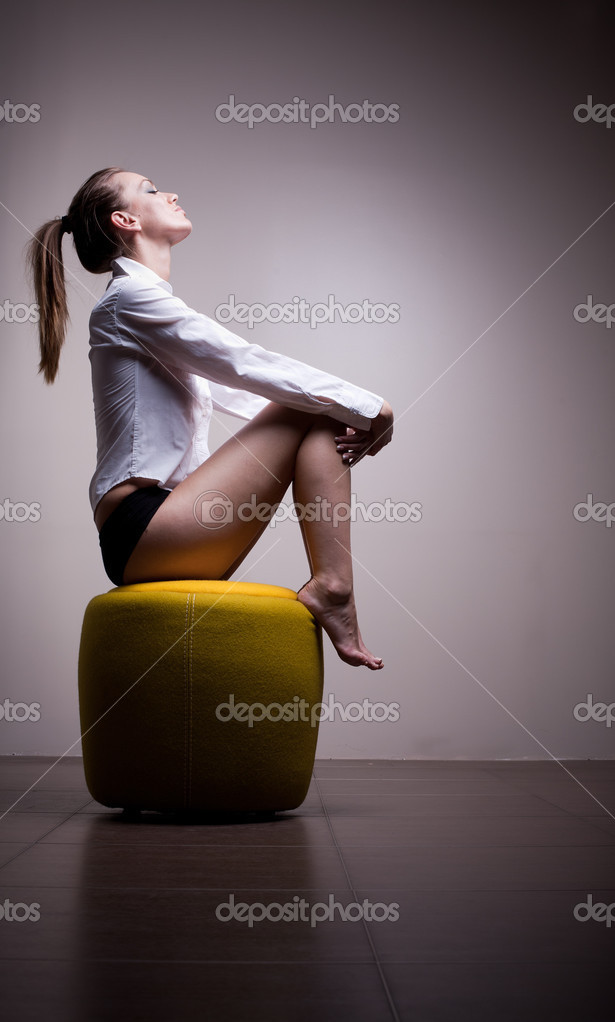 Sexy woman sitting alone in contemplation — Stock Photo #3266387