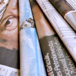 Stack of business newspapers - Stok fotoraf