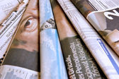 Stack of business newspapers — Stock Photo