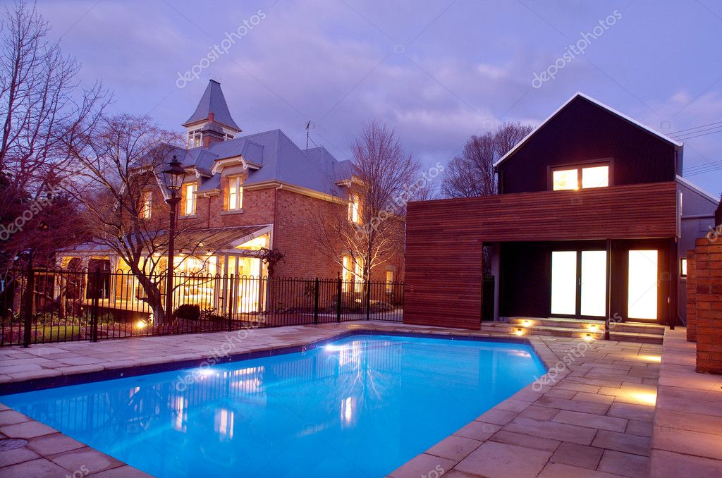 Exterior of beautiful old two storey red brick private residence with inground swimming pool — Stock Photo #2723636