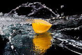 Lemon and splash — Stock Photo