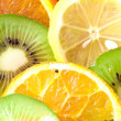 Fruit slices (lemon, kiwi, tangerine, — Stock Photo