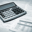 Calculator And Newspaper — Stock Photo