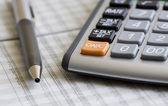 Balancing the Accounts. Calculator, pen — Stock Photo