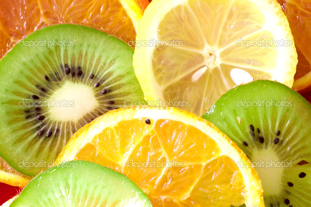Ripe fruit slices overlapped background (lemon, kiwi, tangerine, orange) Studio shot.   Stock Photo #3005868