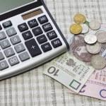 Calculator, polish money and newspaper — Stock Photo #3081298