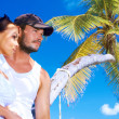 Stock Photo: Couple nex to Palm tree