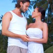 couple nex to palm tree — Stock Photo #3014078
