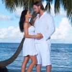 Couple nex to Palm tree — Stock Photo