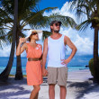 Royalty-Free Stock Photo: Couple nex to Palm tree