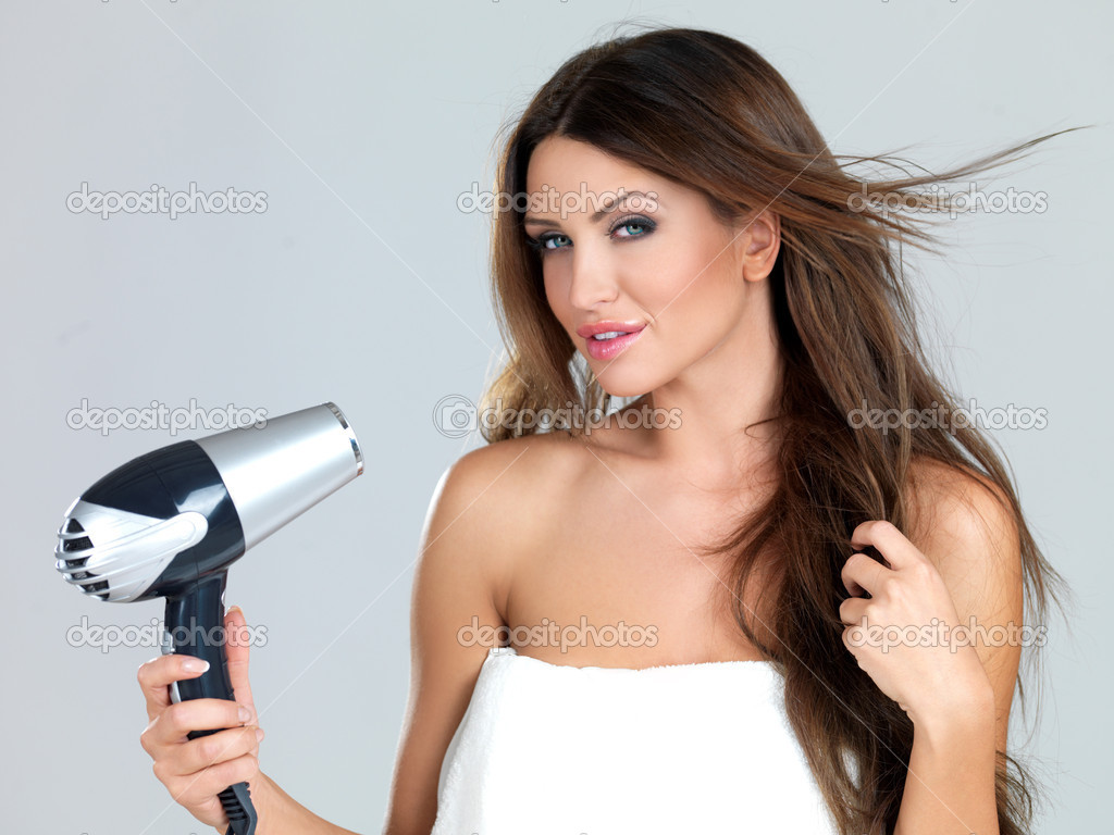 Portrait of beautiful woman, she holding hair dryer — Stock Photo #3784880