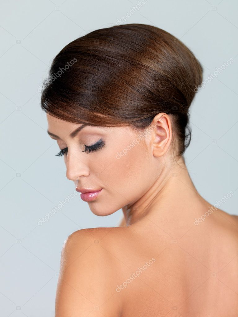 Portrait of beautiful woman, she is isolated on grey — Stock Photo #3799834