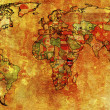 Kenya flag on old world map — Stock Photo