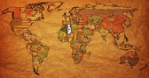 Algeria on old paper world map — Stock Photo