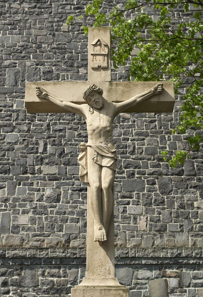 Crucifix in front of the basalt temple  Stock Photo #3113383