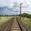 Stock Photo: Straight railway leads to horizon