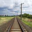 Straight railway leads to horizon — Stock Photo #3844575