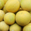 Close up of melons on market stand — Stock Photo