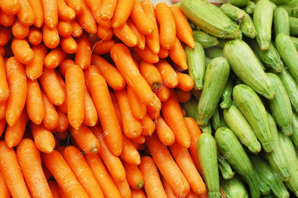Close up of carrot and vegetable marrow on market stand   Stock Photo #3053252
