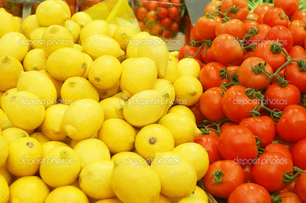 Close up of big lemons and tomatoes on market stand   Stock Photo #3066373