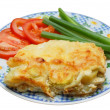 Baked potato pudding with tomato and spring onion — Stock Photo