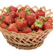 Ripe strawberries in a wicker basket — Stock Photo