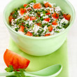 Bowl of curd with tomato and parsley — Stock Photo