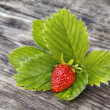 Fresh strawbery on wooden background - Stock Photo