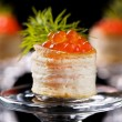 Tartlets with red caviar - Stock Photo