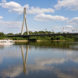 Bridge on vistula river in warsaw - Stock Photo