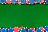 Gambling chips on green felt — Stock Photo