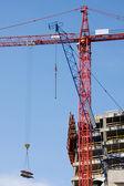 Construction crane on blue sky — Stock Photo
