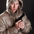 Man in a jacket with a gun in hands — Stock Photo #2724657