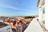 Window view to roofs of Lisbon — Stock Photo