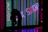Silhouette of young couple against sex shop — Stock Photo