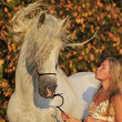 Stock Photo: White horse, girl and wind