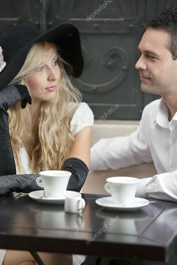 Lovely couple having a chat on a coffee. Canon 5D Mark II.  Stock Photo #3916577