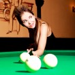 Foto de Stock  : Girl playing billiard