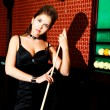 Woman playing billiard - Stock Photo