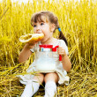 Girl eating a long loaf — Stock Photo #3184597