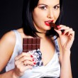 Girl eating chocolate — Stock Photo #3185346