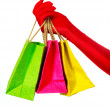 Hand with three shopping bags — Stock Photo