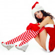 Girl dressed as Santa — Stock Photo #3189822
