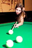 Girl playing billiard — Stock Photo