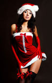 Sexy girl dressed as Santa — Stock Photo