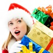 Surprised girl with a lot of Christmas presents — Stock Photo #3190150
