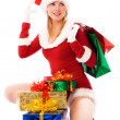 Pretty girl with Christmas presents — Stockfoto